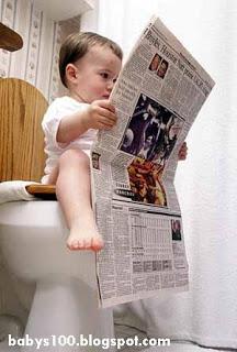 Cute_baby_reading_newspaper